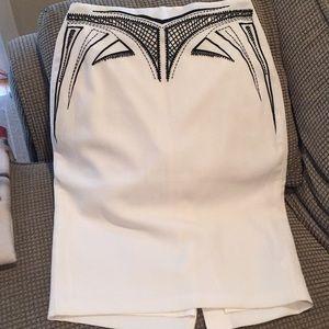 Bebe cream skirt with black beaded pattern.